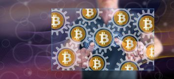 Man touching a bitcoin concept. On a touch screen with his fingers royalty free stock image