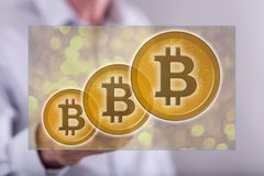 Man touching a bitcoin currency concept. On a touch screen with a pen Stock Photography