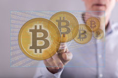 Man touching a bitcoin currency concept on a touch screen Royalty Free Stock Photography
