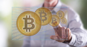Man touching a bitcoin currency concept on a touch screen Stock Images