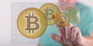 Man touching a bitcoin currency concept on a touch screen Stock Photography
