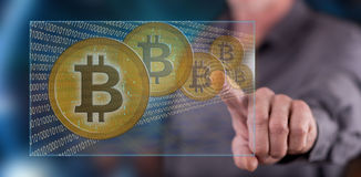 Man touching a bitcoin currency concept on a touch screen Stock Photos