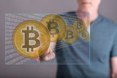 Man touching a bitcoin currency concept on a touch screen Royalty Free Stock Photo