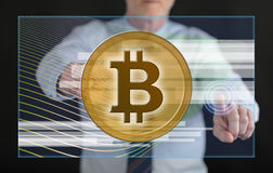 Man touching a bitcoin currency concept on a touch screen Royalty Free Stock Image