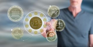 Man touching a bitcoin regulation concept. On a touch screen with his finger royalty free stock photo