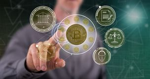 Man touching a bitcoin regulation concept. On a touch screen with his finger stock photo