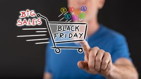 Man touching a black friday concept on a touch screen. With his finger Royalty Free Stock Photo
