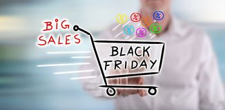 Man touching a black friday concept on a touch screen. With his finger Royalty Free Stock Images