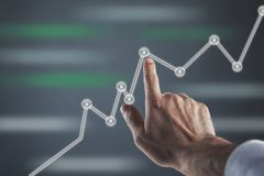 Man touching business charts royalty free stock image