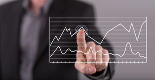 Man touching business charts on a touch screen Stock Photography