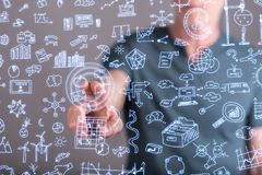 Man touching business doodles. On a touch screen with his finger Stock Photos