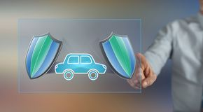 Man touching a car insurance concept. On a touch screen with his finger royalty free stock photos