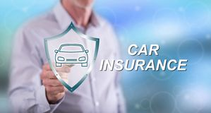 Man touching a car insurance concept. On a touch screen with a pen stock image