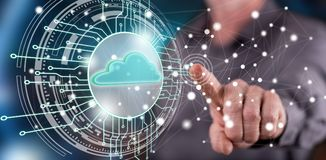 Man touching a cloud computing system concept. On a touch screen with his finger stock photo