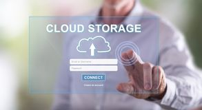 Man touching a cloud storage concept on a touch screen Royalty Free Stock Images