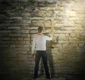 Man is Touching a Cross. Man is Touching a Jesus Christ Cross Royalty Free Stock Images