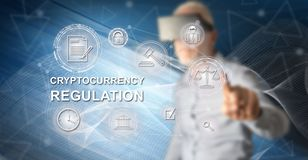 Man touching a cryptocurrency regulation concept. Man with vr headset ing a cryptocurrency regulation concept on a screen with his finger stock photos