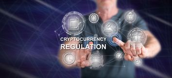 Man touching a cryptocurrency regulation concept. On a touch screen with his fingers royalty free stock photography