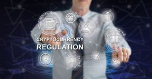 Man touching a cryptocurrency regulation concept. On a touch screen with his fingers stock photos