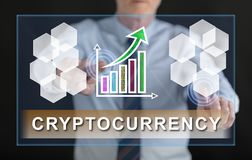 Man touching a cryptocurrency success concept on a touch screen. With his fingers Stock Image