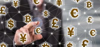 Man touching a currency network concept on a touch screen Royalty Free Stock Images