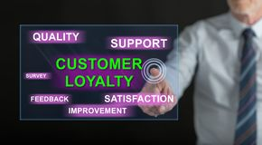 Man touching a customer loyalty concept. On a touch screen with his finger royalty free stock image