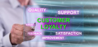 Man touching a customer loyalty concept. On a touch screen with a pen royalty free stock photography