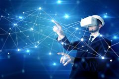 Man touching 3D connectivity and network signs. Businessman in virtual reality goggles investigate global network connectivity concept royalty free stock image