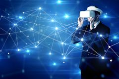 Man touching 3D connectivity and network signs. Businessman in virtual reality goggles investigate global network connectivity concept stock photos