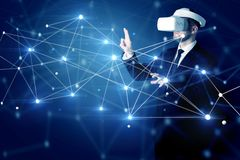 Man touching 3D connectivity and network signs. Businessman in virtual reality goggles investigate global network connectivity concept royalty free stock photography