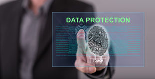 Man touching a data protection concept on a touch screen. With his finger Royalty Free Stock Images