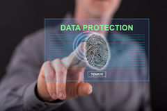 Man touching a data protection concept on a touch screen. With his finger Royalty Free Stock Photos