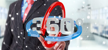 Man touching 360 degree 3D render icon with his finger. Man on blurred background touching 360 degree 3D render icon with his finger Stock Image