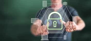 Man touching a devices security concept. On a touch screen with his fingers royalty free stock images