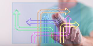 Man touching a digital decision concept on a touch screen. With his finger Stock Images