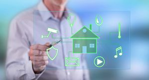 Man touching a digital smart home automation concept. On a touch screen with a pen royalty free stock photo