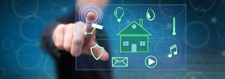 Man touching a digital smart home automation concept. On a touch screen with his finger stock photography