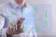 Man touching a digital smart home automation concept on a touch screen Stock Images