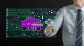 Man touching a digital smart home automation concept on a touch screen. With his finger Royalty Free Stock Image