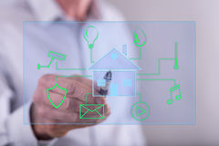 Man touching a digital smart home automation concept on a touch screen. With a pen Stock Photo