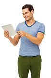 Man Touching Digital Tablet While Standing Against White Backgro Stock Image