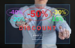 Man touching a discount concept. On a touch screen with his fingers Stock Images