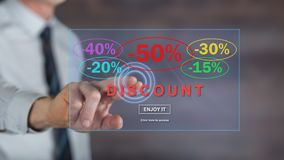 Man touching a discount concept on a touch screen. With his finger Stock Photos