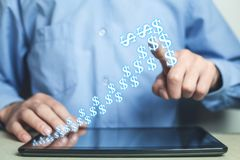 Man touching dollars arrow. Currency growth concept. Royalty Free Stock Images