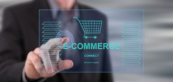Man touching an e-commerce concept. On a touch screen with his finger stock images