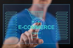 Man touching an e-commerce concept. On a touch screen with his finger stock photos