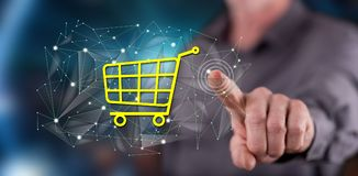 Man touching an e-commerce concept. On a touch screen with his finger royalty free stock photo