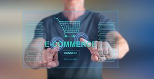 Man touching an e-commerce concept on a touch screen. With his fingers stock photography