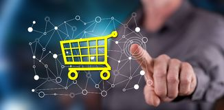 Man touching an e-commerce concept on a touch screen. With his finger royalty free stock photography