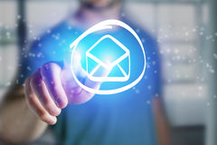 Man touching a email icon on a futuristic interface - Technology. View of a Man touching a email icon on a futuristic interface - Technology concept Royalty Free Stock Photos
